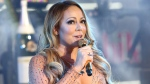 In this Dec. 31, 2016, file photo, Mariah Carey performs at the New Year's Eve celebration in Times Square in New York. (Photo by Greg Allen/Invision/AP, File)