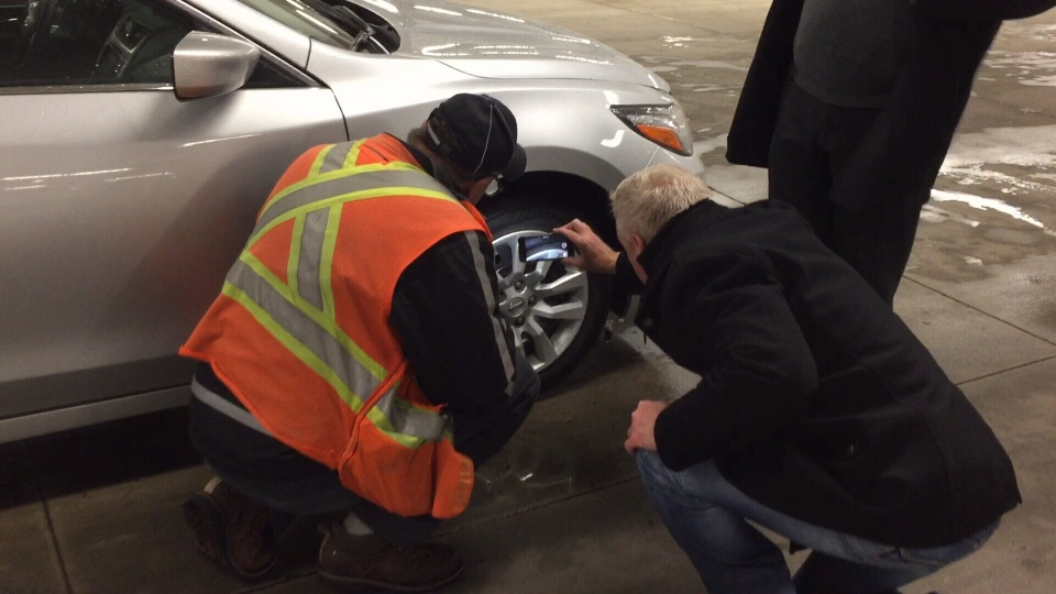 CTV's Ross McLaughlin checks the tires on a rental vehicle to ensure it's equipped with winter tires.
