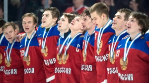 Members of team Russia sing along with the national anthem following their bronze medal victory over Sweden at the IIHF World Junior Championship Thursday, January 5, 2017 in Montreal. (THE CANADIAN PRESS/Paul Chiasson)