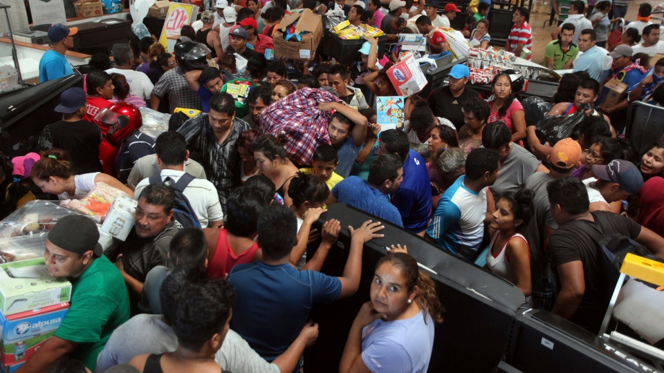 People ransack a store in Veracruz, Mexico, Thursday Jan. 5, 2017. Anger over gasoline prices hikes is fueling more protests and looting. Officials say the unrest has resulted in the death of a policeman, the ransacking of hundreds of stores and arrests of hundreds of people. (AP Photo / Felix Marquez)