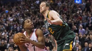 Toronto Raptors guard Kyle Lowry battles against Utah Jazz forward Joe Ingles during second half NBA basketball action in Toronto on Thursday, January 5, 2017. (Nathan Denette / THE CANADIAN PRESS)