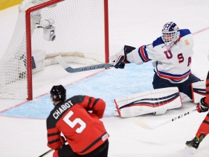 Canada defenceman Thomas Chabot (5) scores on United States goaltender Tyler Parsons (1) during first period gold medal game hockey action at the IIHF World Junior Championship, Thursday, January 5, 2017 in Montreal. (THE CANADIAN PRESS/Ryan Remiorz)