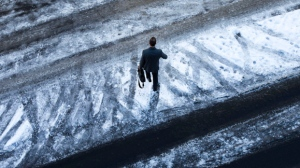 A pedestrian makes his way across an icy Willamette Street in Eugene, Oregon, Thursday Jan. 5, 2017, after a snow storm dumped several inches of snow on the area. (Chris Pietsch/The Register-Guard via AP)