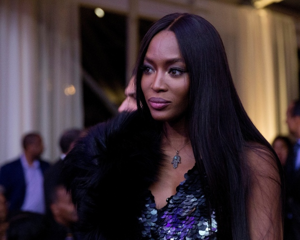 In this Oct. 21, 2016, file photo, model Naomi Campbell, centre, arrives at a BET event hosted by President Barack Obama and first lady Michelle Obama on the South Lawn of the White House, in Washington. (AP Photo/Carolyn Kaster, File)