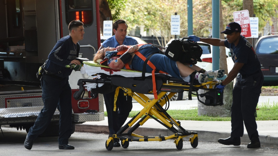 An injured woman is taken into Broward Health Trauma Center in Fort Lauderdale, Fla., after a shooting at the Fort Lauderdale-Hollywood International Airport on Friday, Jan. 6, 2017. (Taimy Alvarez / South Florida Sun-Sentinel via AP)