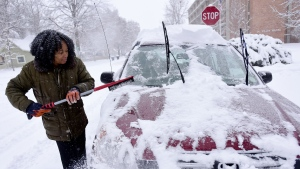 Alexis Miles, of Longmont, Colo., clears snow from her car on Pratt Street on Thursday, Jan. 5, 2017, in Longmont, Colo. (Matthew Jonas/The Daily Times Call via AP)