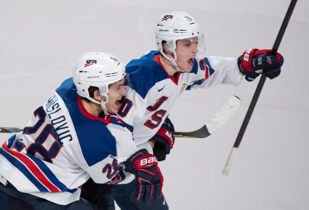 United States' Troy Terry, right, celebrates with teammate Jack Roslovic after scoring in the shootout to beat Russia 4-3 during IIHF World Junior Championship semifinal hockey action in Montreal on Wednesday, January 4, 2017. (Paul Chiasson / THE CANADIAN PRESS)