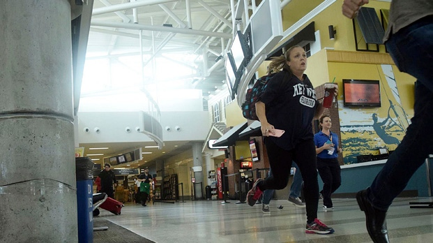Passengers run for cover in Terminal 1 at Fort Lauderdale–Hollywood International Airport, Friday, Jan. 6, 2017, in Fort Lauderdale, Fla. (Paul E. Kostyu via AP)