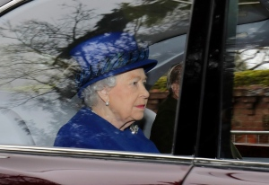 Queen Elizabeth II in a car with Prince Philip, arrives to attend the morning church service at St Mary Magdalene Church in Sandringham, England, Sunday Jan. 8, 2017. (Chris Radburn / PA via AP)