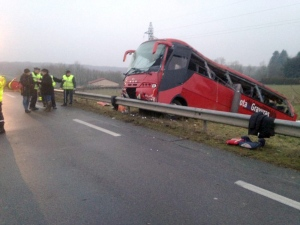 In this photo taken Sunday, Jan. 8, 2017, and provided by Creusot Infos, police officers investigate at the scene of a bus crash near Charolles, central France, Sunday, Jan. 8, 2017. (Creusot Infos via AP)