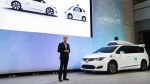 John Krafcik, CEO of Waymo Inc., the autonomous vehicle company created by Google's parent company, introduces a Chrysler Pacifica hybrid outfitted with Waymo's own suite of sensors and radar at the North American International Auto Show in Detroit on Sunday, Jan. 8, 2017. (AP / Paul Sancya)