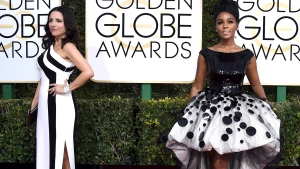 Julia Louis-Dreyfus, left, and Janelle Monae arrive at the 74th annual Golden Globe Awards at the Beverly Hilton Hotel on Sunday, Jan. 8, 2017, in Beverly Hills, Calif. (Photo by Jordan Strauss/Invision/AP)
