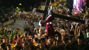 Filipino Roman Catholic devotees carry the image of the Black Nazarene for a procession to celebrate its feast day Monday, Jan. 9, 2017 in Manila, Philippines. (AP / Bullit Marquez)