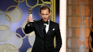 """This image released by NBC shows Tom Hiddleston with the award for best actor in a limited series or TV movie for """"The Night Manager,"""" at the 74th Annual Golden Globe Awards at the Beverly Hilton Hotel in Beverly Hills, Calif., on Sunday, Jan. 8, 2017. (Paul Drinkwater/NBC via AP)"""