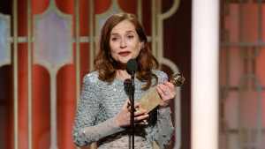 """This image released by NBC shows Isabelle Huppert accepting the award for best actress in a motion picture drama for her role in """"Elle"""" at the 74th Annual Golden Globe Awards at the Beverly Hilton Hotel in Beverly Hills, Calif., on Sunday, Jan. 8, 2017. (Paul Drinkwater/NBC via AP)"""
