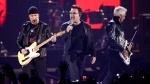 The Edge, from left, Bono and Adam Clayton of the music group U2 perform at the 2016 iHeartRadio Music Festival at T-Mobile Arena in Las Vegas on Sept. 23, 2016. (John Salangsang / Invision)