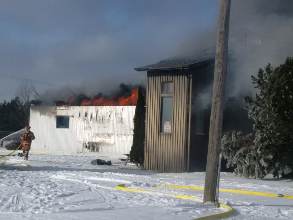 Firefighters were called to this property on the 7th Line in Guelph/Eramosa on Monday, Jan. 9, 2017. (Jonathan Karn / Twitter)