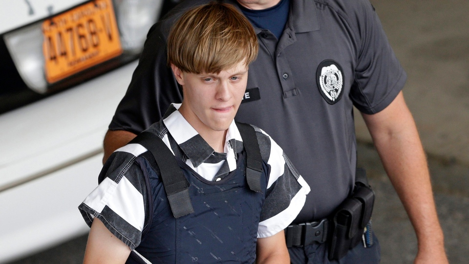 In this June 18, 2015 file photo, Charleston, S.C., shooting suspect Dylann Roof is escorted from the Cleveland County Courthouse in Shelby, N.C. (AP Photo/Chuck Burton, File)