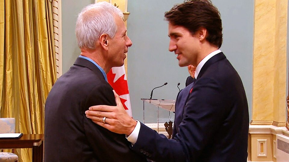 Stephane Dion and Prime Minister Justin Trudeau shake hands in 2015
