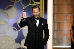 This image released by NBC shows Tom Hiddleston with the award for best actor in a limited series or TV movie for 'The Night Manager,' at the 74th Annual Golden Globe Awards at the Beverly Hilton Hotel in Beverly Hills, Calif., on Sunday, Jan. 8, 2017. (Paul Drinkwater/NBC via AP)