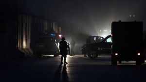 A member of the Afghan security forces stands guard at the site of a twin bombing in Kabul, Afghanistan, on Jan. 10, 2017. (Massoud Hossaini / AP)