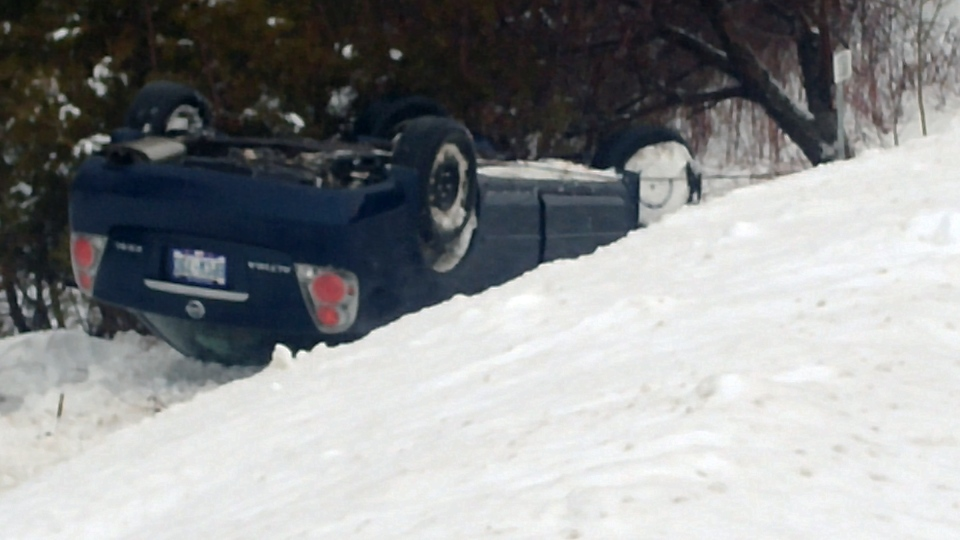 Nobody was hurt when a car ended up on its roof in a ditch along Notre Dame Drive in Wellesley Township on Tuesday, Jan. 10, 2017. (Daryl Morris / CTV Kitchener)