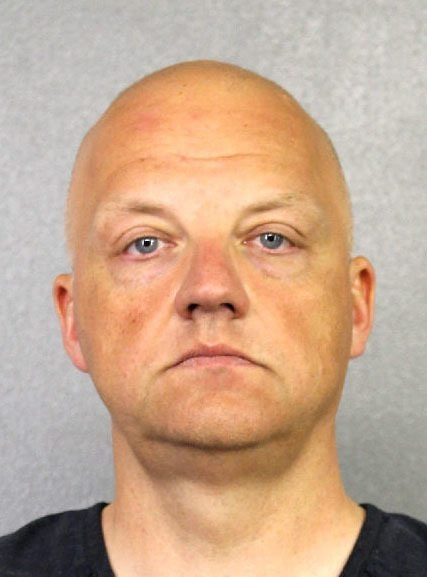 This undated photo provided by the Broward County Sheriff's Office shows Oliver Schmidt under arrest on Jan. 7, 2017. Schmidt, the general manager of the engineering and environmental office for Volkswagen America, was arrested in connection with the company's emissions-cheating scandal. (Broward County Sheriff's Office via AP, File)