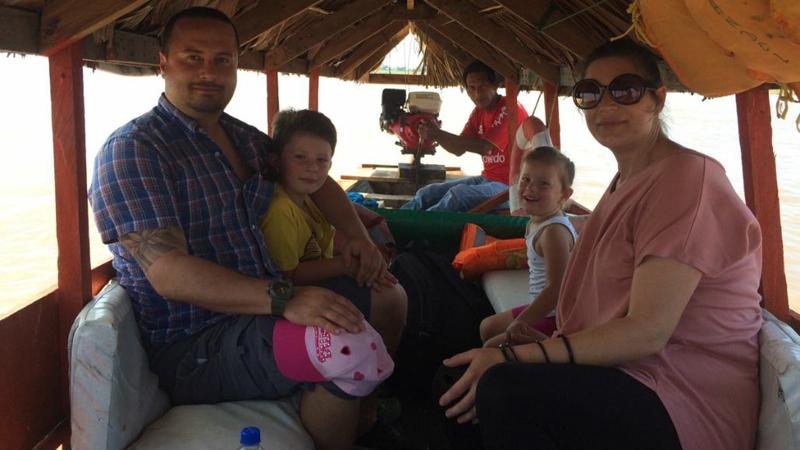 Family photo of Kimberlee Kasatkinm, her husband and two children.