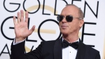 Michael Keaton arrives at the 74th annual Golden Globe Awards at the Beverly Hilton Hotel in Beverly Hills, Calif. on Sunday, Jan. 8, 2017. (Jordan Strauss/Invision)