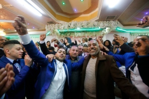 In this Dec. 31, 2016 photo, Arab families of African descent attend a wedding in the West Bank city of Ramallah. (AP Photo/Nasser Shiyoukhi).