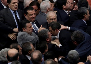 Ruling Justice and Development Party and main opposition Republican People's Party legislators scuffle in Turkey's parliament during deliberations over a controversial package of constitutional amendments that would greatly expand President Recep Tayyip Erdogan's powers, in Ankara, Turkey, Wednesday, Jan. 11, 2017. (AP)