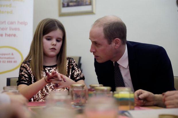 In this Wednesday, Jan. 11, 2017 file photo, Britain's Prince William speaks to Aoife, 9, during his visit to a Child Bereavement UK Centre in Stratford in east London. (AP / Matt Dunham)