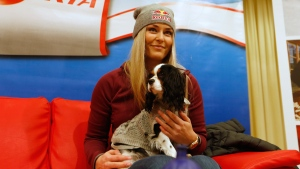 United States' Lindsey Vonn holds her dog Lucy during a news conference in Altenmarkt-Zauchensee, Austria, on Jan. 12, 2017. (Marco Trovati / AP)