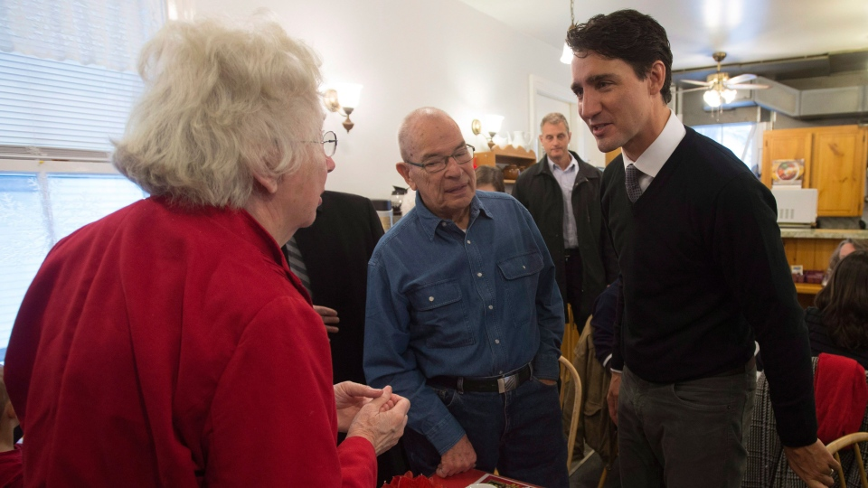 Prime Minister Justin Trudeau speaks with locals as he visits a restaurant in Manotick, Ont. Thursday Jan. 12, 2017. (Adrian Wyld / THE CANADIAN PRESS)