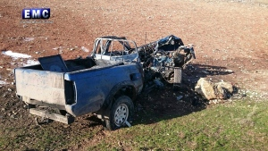 This photo released on Wednesday, Jan. 11, 2017 by the Edlib Media Center, an opposition activist media collective, which has been authenticated based on its contents and other AP reporting, shows a vehicle that was hit in an aerial attack in the northwestern Syrian province of Idlib. (Edlib Media Center via AP)