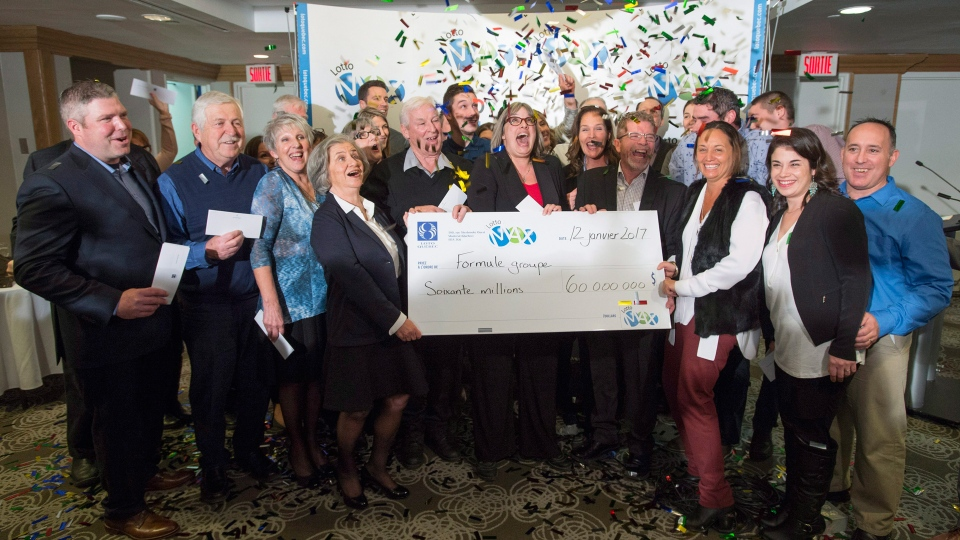 Twenty eight members of a same Quebec family celebrate after receiving their cheques sharing a $60 million lottery win, Thursday, January 12, 2017 in Montreal, the biggest prize awarded ever by Loto-Quebec.(Paul Chiasson/THE CANADIAN PRESS)