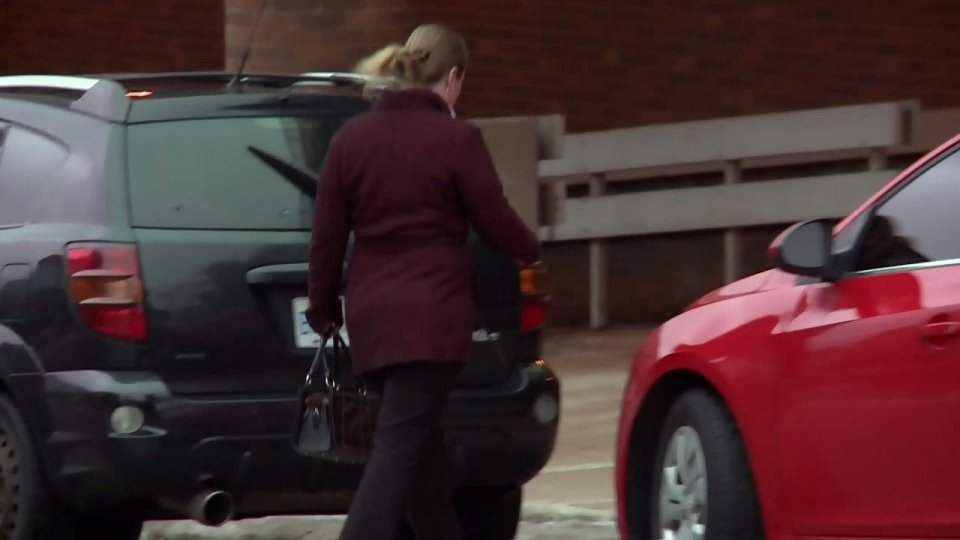 Breanna Flynn walks outside the Kitchener courthouse.