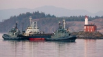 The MV Sun Sea is shown being escorted past Fisgard Lighthouse and into CFB Esquimalt in Colwood, B.C., Friday, Aug. 13, 2010. (THE CANADIAN PRESS/Jonathan Hayward)