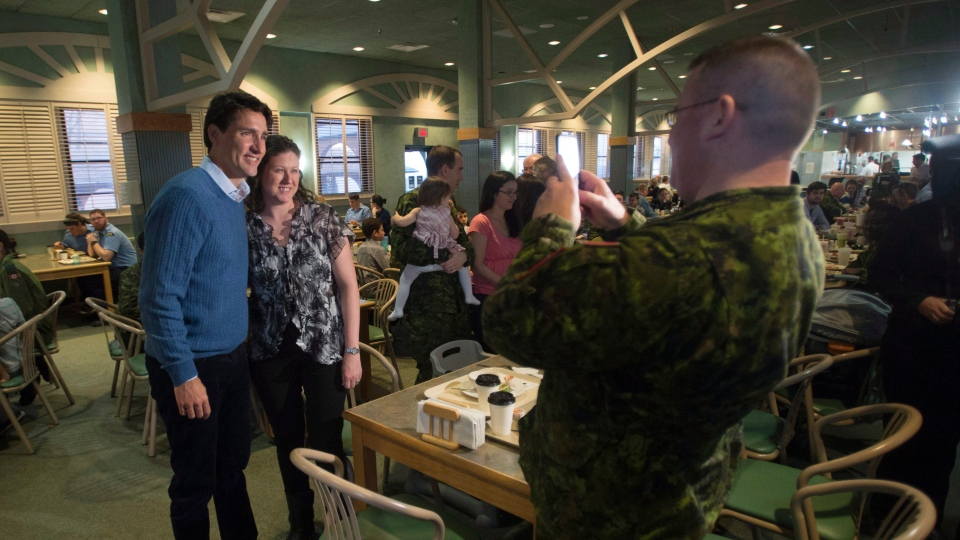Prime Minister Justin Trudeau poses for a photo as he visits a base mess hall at CFB Trenton in Trenton, Ont. Friday, Jan. 13, 2017. (Adrian Wyld/THE CANADIAN PRESS)