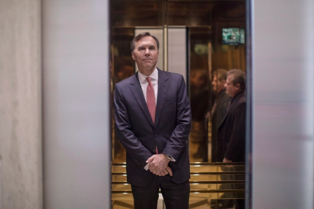 Federal Finance Minister Bill Morneau stands behind a closing elevator door after briefing journalists following a meeting with leading private sector economists in Toronto, on Friday January 13, 2017. (Chris Young / THE CANADIAN PRESS)