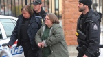 Elizabeth Wettlaufer is escorted into the courthouse in Woodstock, Ontario on Friday, Jan. 13, 2017. (Dave Chidley/The Canadian Press)