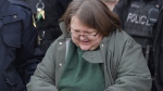 Elizabeth Wettlaufer is escorted from the courthouse in Woodstock, Ont., on Friday, Jan. 13, 2017. (Dave Chidley/The Canadian Press)