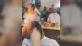 Hot hairdo! Barber sets customer's hair ablaze