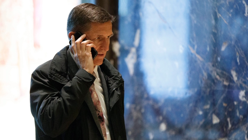 Trump aide Michael Flynn walks in the lobby of Trump Tower in New York, Thursday, Jan. 12, 2017. (AP Photo / Evan Vucci)