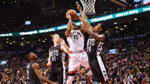 Toronto Raptors guard DeMar DeRozan (10) drives against Brooklyn Nets forward Rondae Hollis-Jefferson (24) as Nets guard Caris LeVert (22) and Nets centre Justin Hamilton (41) look on during second half NBA basketball action in Toronto on Friday, January 13, 2017. THE CANADIAN PRESS/Frank Gunn