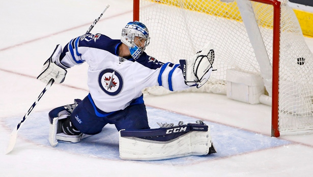 Winnipeg Jets goalie Connor Hellebuyck during an NHL hockey game Friday, Jan. 13, 2017. The Winnipeg Jets became the first NHL team to acknowledge the colonial history of their arena, making a commitment in October to announce the traditional landholders of the area at each home game.  (AP Photo/Ross D. Franklin)