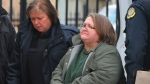 Elizabeth Wettlaufer is escorted into the courthouse in Woodstock, Ontario on Friday, Jan. 13, 2017. (Dave Chidley / THE CANADIAN PRESS)