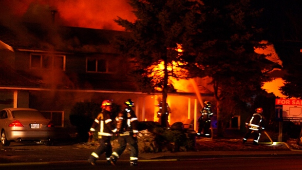 Firefighters work to extinguish a house fire in Abbotsford on Saturday, Jan. 14, 2017.