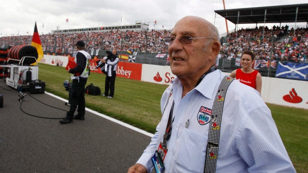 FILE - A Sunday, June 21 2009 photo from files of Stirling Moss, the legendary British Racing driver attending the British Formula One Grand Prix at the Silverstone racetrack, in Silverstone, England. (AP Photo/Luca Bruno, File)