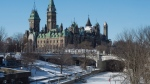 The Parliament buildings are seen near Rideau Canal Thursday January 21, 2016 in Ottawa. (THE CANADIAN PRESS / Adrian Wyld)